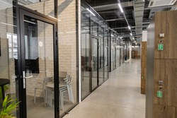 Modern empty office with glass partitions, loft style interior. Perspective view.