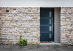 Modern entry house with stone wall