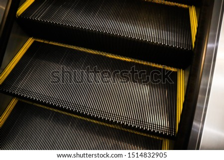 Modern escalator  in  modern shopping mall interior.