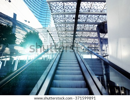 modern escalator in shopping center #371599891