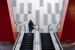 Modern escalator with people for facilities in a contemporary building