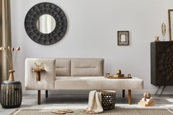Modern ethnic living room interior with design chaise lounge, round mirror, furniture, carpet, decoration, stool and elegant personal accessories. Template. Stylish home decor.
