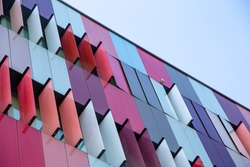 Modern exterior of a colorful office building in Milan, Italy