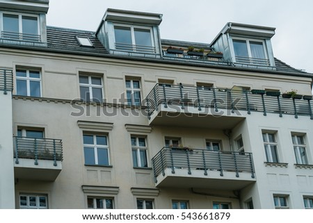 modern facaded building with new renovated balconies #543661879