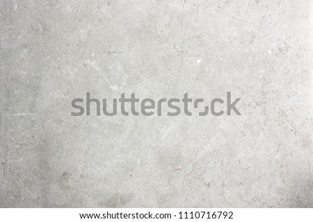Modern fade soft grey paint limestone material texture background in flat white light concrete stone fortress wall paper. Gray table floor concept seamless marble desk granite grunge stucco pattern.