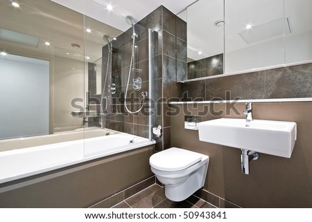 Modern Family Bathroom With Large Bath Tub And Natural Stone Tiled ...