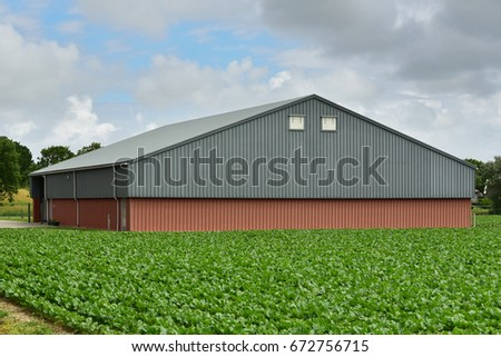 Modern farm barn for storage of the harvest or agricultural machinery in Friesland