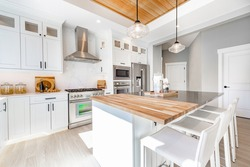 Modern farmhouse kitchen with butcher block countertop