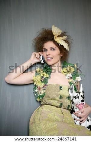 Modern fashion original woman talking phone with dalmatian dog