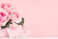 Modern fashion Valentine days background - rich roses, trendy pink heart with ribbon and gift box on white wood board, copy space.