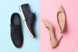 modern fashionable classic shoes, men's and women's shoes on a colored background top view.
