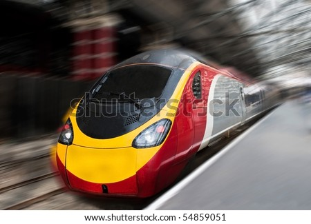 Modern Fast Passenger Commuter Train in the Station with Motion Blur