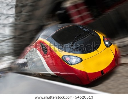 Modern Fast Passenger Speed Commuter Train in the Station with Motion Blur. Tilted View