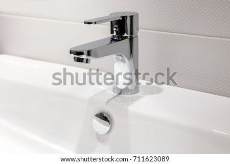 Modern faucet of chrome color in bathroom interior #711623089
