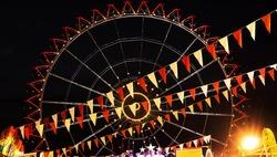 Modern ferris wheel in the night. Free time activities. Amusement park. Russian wheel.