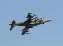 Modern fighter jet performing vertical takeoff