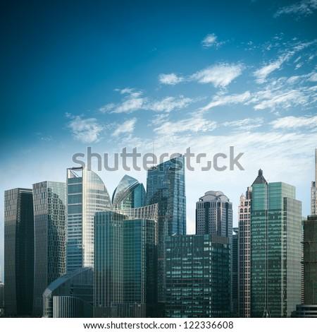 modern financial buildings against a blue sky in shanghai