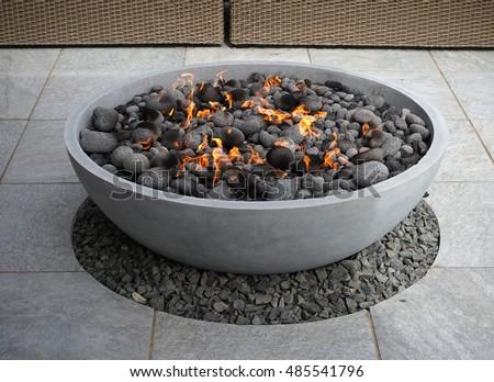 modern fire pit on backyard patio