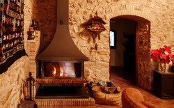 Modern fireplace in the living room of natural stone. Rustic and medieval room. Traditional spanish country style.