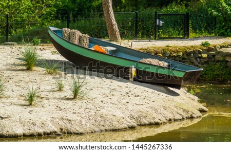 modern fishers boat on the embankment, Fishing sport equipment, recreational sports #1445267336