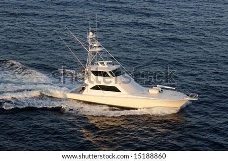 Modern fishing boat heading out to see top view