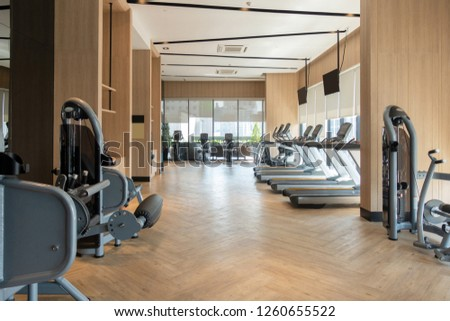 Modern fitness center with gym equipment decoration. interior design background #1260655522