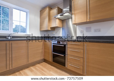 Fitted kitchen units within new home including built in appliances