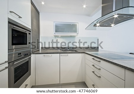 modern fitted kitchen with luxury electric appliances