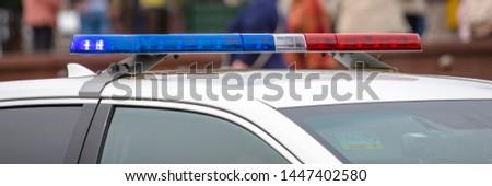 modern flashing lights on a police car #1447402580