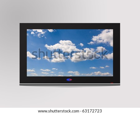 Modern flat television set with cloudscape on screen,  over a gray wall