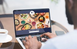 Modern food and fast delivery at home or office. African american man uses laptop and order meal on website at screen of gadget, sitting at table with coffee and smartphone, collage, collage, cropped