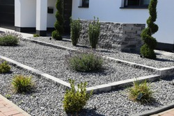 Modern front yard with decorative gravel