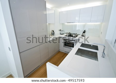 Modern fully fitted kitchen with appliances in white