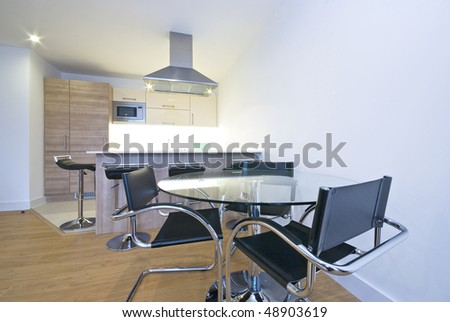 Modern fully fitted kitchen with dining area