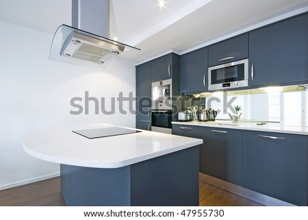 Modern fully fitted kitchen with kitchen appliances