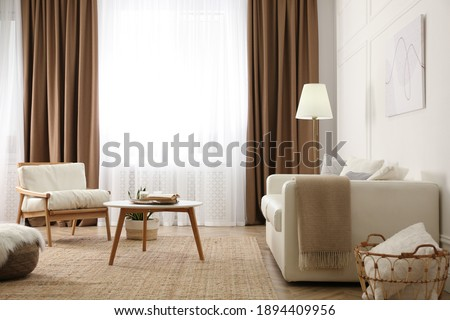 Modern furniture and window with curtains in stylish room interior Stockfoto ©