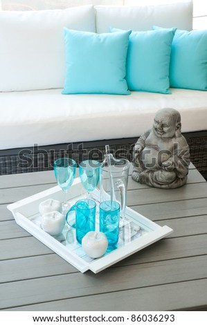Modern garden furniture with Buddha statue on the table
