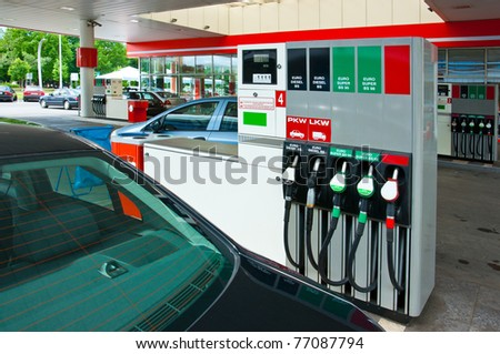 modern gas station with cars