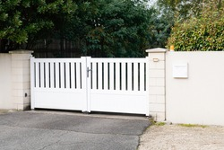modern gate in white aluminum with blades of suburbs house