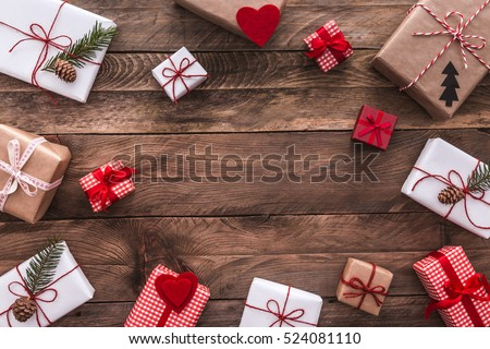 Modern gifts on a wooden rustic table with copy space. Christmas background. View from above. Flat lay