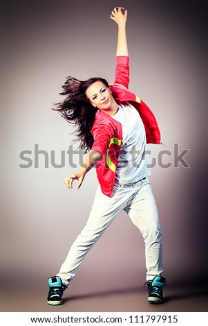 Modern girl dancing hip-hop at studio.