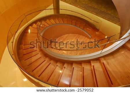 Modern glass an wooden spiral staircase