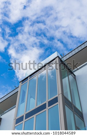 Modern glass archetecture with blue sky