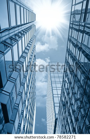 modern glass building under the sun in hong kong #78582271