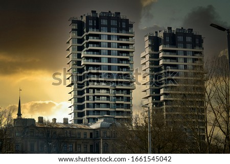 Modern glass building with reflected evening city and sunset sky in it. Stockfoto ©