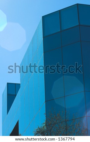 Modern glass business building with natural lens flare