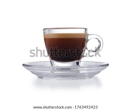 Modern glass expresso cup and saucer full of smooth expresso coffee, isolated on white with a slight drop shadow Foto d'archivio ©