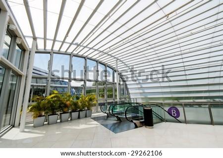 Modern glass shelter over escalators