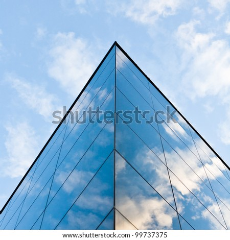 Modern glass silhouettes on modern building