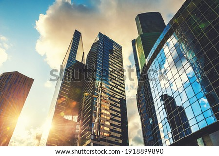 Modern glass skyscrapers against the sky at sunset. Bottom up view. Moscow, Russia